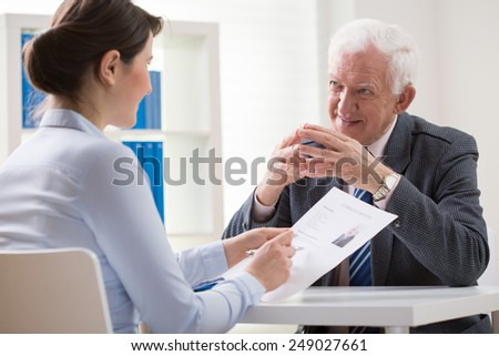 Elder man answering the questions on job interview - stock photo