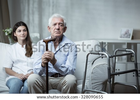 Elder man is very sad in the retirement home - stock photo