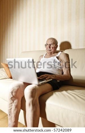 elder man with laptop - stock photo