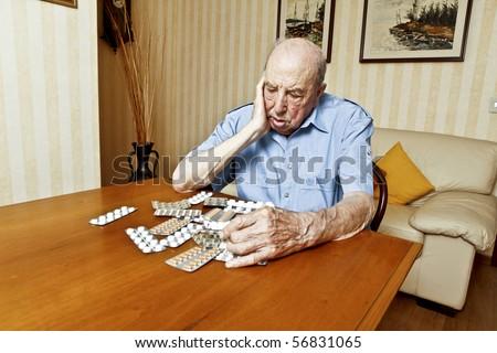 elder man with pills - stock photo