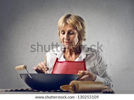 elder woman cooking - stock photo