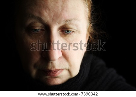 elder woman deep in thoughts (special film-looking photo f/x)