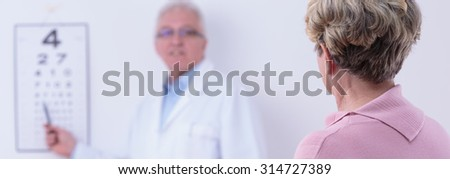 Elder woman is checking out her sight