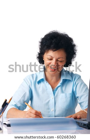 Elder woman writing something with a pencil - stock photo