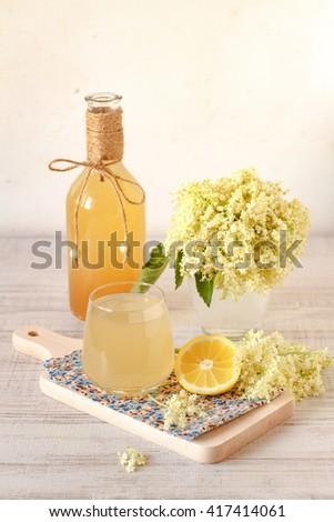 Elderberry flower drink with sliced lemon  - stock photo