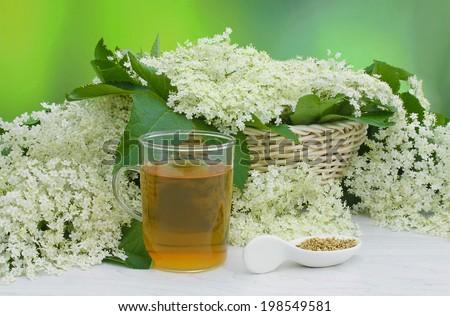elderberry flowers decorations and elderberry flowers tea - stock photo