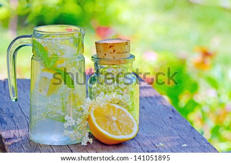 Elderflower and lemon juice shoot in garden - stock photo