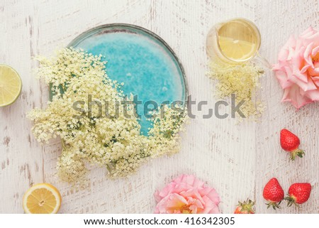 Elderflower, rose and strawberry sorbet, A still life featuring elder flowers, roses and strawberries for making sorbet. Top view, vintage toned image - stock photo