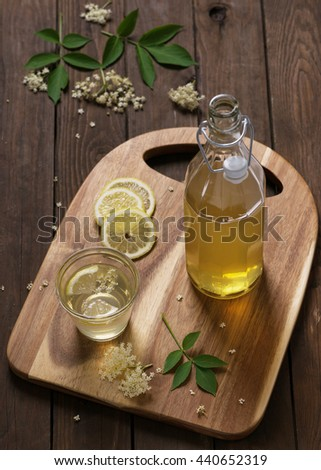 Elderflower syrup. Homemade elder flower syrup with a slice of lemon. Top view. - stock photo