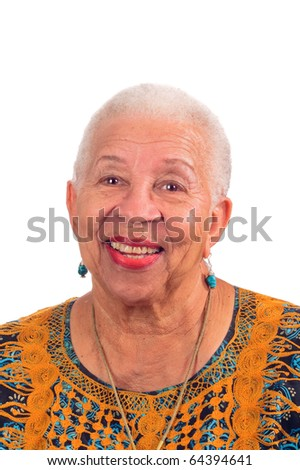 Elderly African American woman smiling from a pleasant surprise - stock photo
