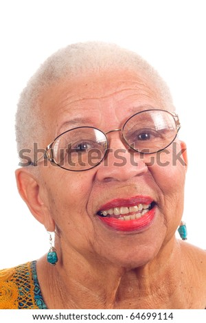 Elderly African American woman with spectacles on and smiling, isolated on white - stock photo