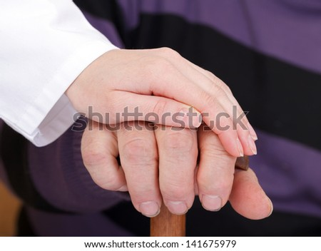 Elderly and young hands - stock photo