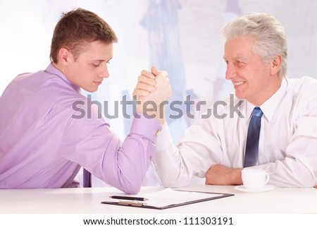 Elderly and young men, working in very different fields of activity - stock photo