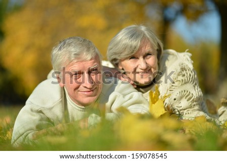 elderly attractive woman outdoors in autumn