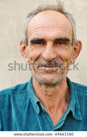 Elderly bald man, natural smile and positive grimace - stock photo
