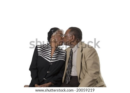 Elderly black couple kissing - stock photo