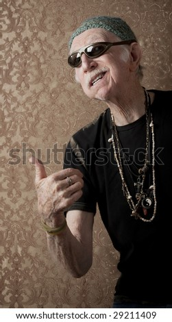 Elderly Bouncer Telling Viewer to Keep Moving - stock photo