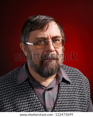 Elderly business man in spacticles posing on rad background