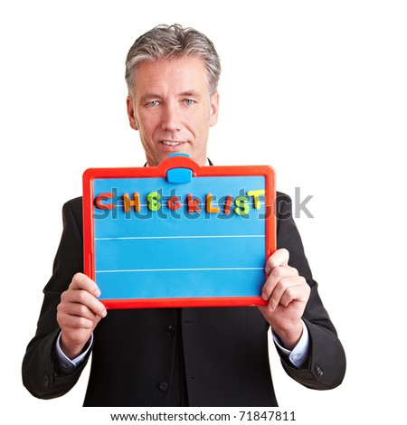 Elderly business man showing empty checklist on magnetic board - stock photo