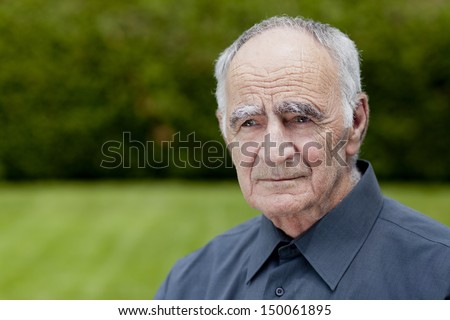 Elderly calm, man lost in thought - stock photo