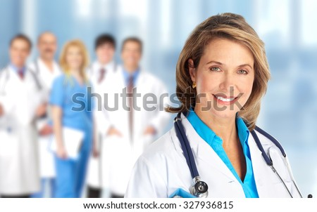 Elderly clinic doctor woman over hospital background. - stock photo