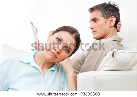 Elderly couple at home giving each other the silent treatment - stock photo