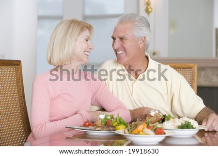 Elderly Couple Enjoying Healthy meal,mealtime Together - stock photo