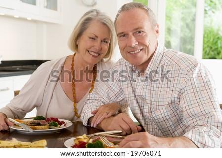 Elderly Couple Enjoying meal,mealtime Together - stock photo