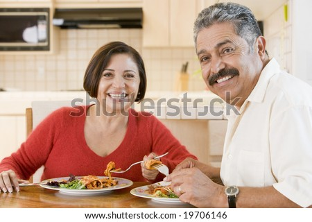 Elderly Couple Enjoying meal,mealtime Together - stock photo