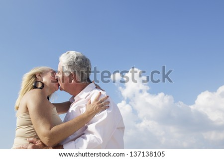 Elderly couple in love, honeymoon with old man and woman kissing. Copy space - stock photo