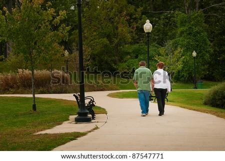 Elderly Couple in Park - stock photo