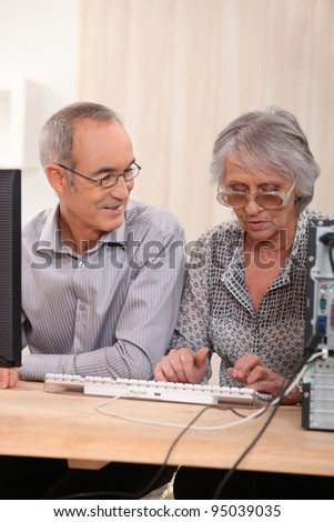 Elderly couple learning computer skills