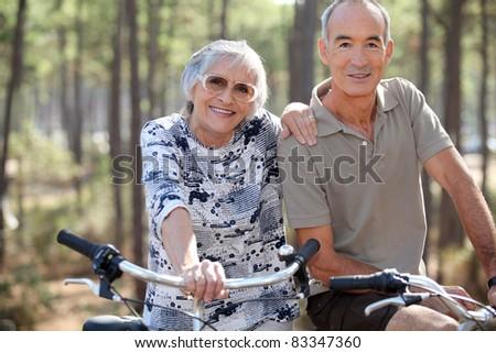 Elderly couple on bike ride - stock photo