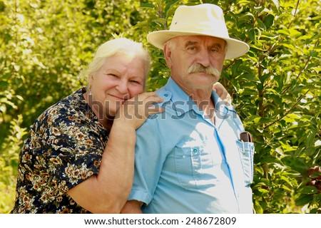 elderly couple on nature - stock photo