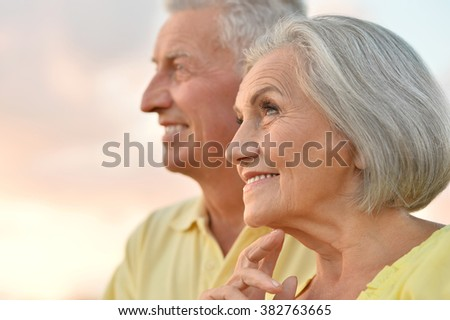 elderly couple  on the background of sky