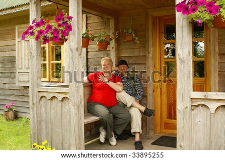 Elderly couple on veranda