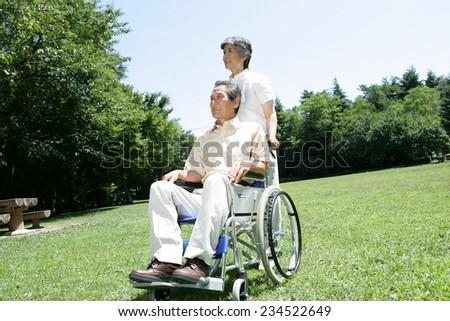 Elderly Couple on Wheelchairs - stock photo