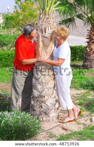 Elderly couple playfully looks at each other.