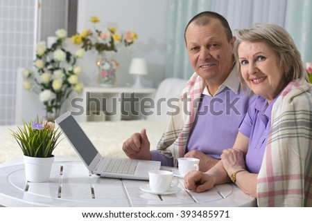 elderly couple resting and drinking tea - stock photo