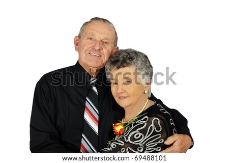 Elderly couple smartly dressed on a white background with space for text - stock photo