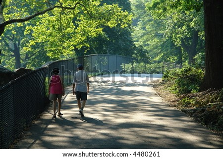 Elderly couple speed walking in Central Park new york city - stock photo