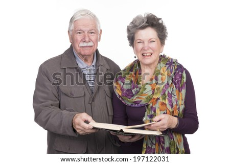 Elderly couple standing  with a bible in hand
