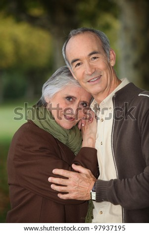 Elderly couple taking a walk - stock photo