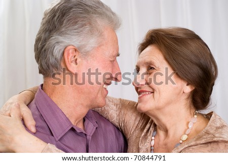 elderly couple together on a white