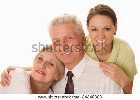 elderly couple with a daughter - stock photo