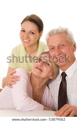 elderly couple with a daughter on a white