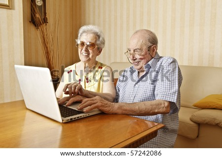 elderly couple with laptop - stock photo