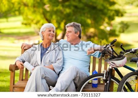 Elderly couple with their bikes - stock photo