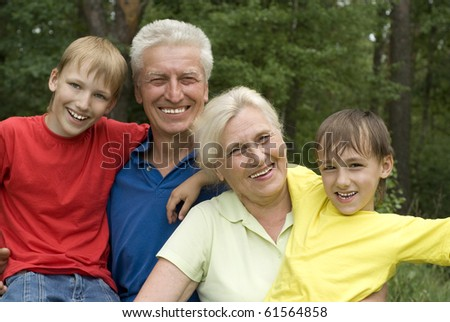 elderly couple with their grandchildren in a summer park