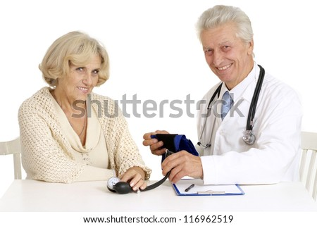 elderly doctor and patient on a white